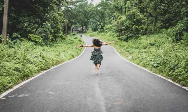 woman running on road